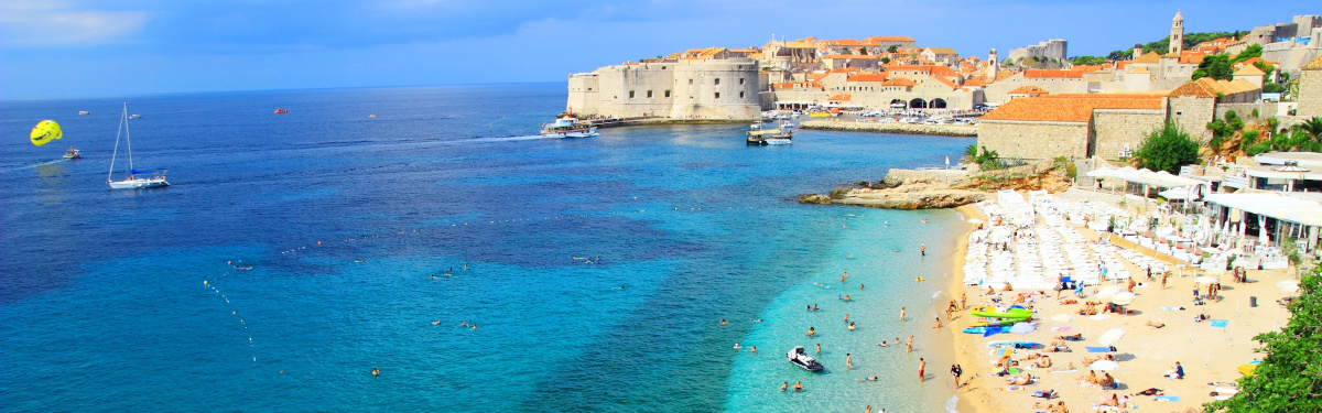 Beautiful beach Banje and Dubrovnik touristic destination in background, Croatia