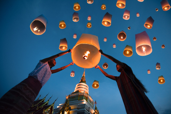 people release floating lanterns ballon to blue sky for make a wish for the future, Thailand