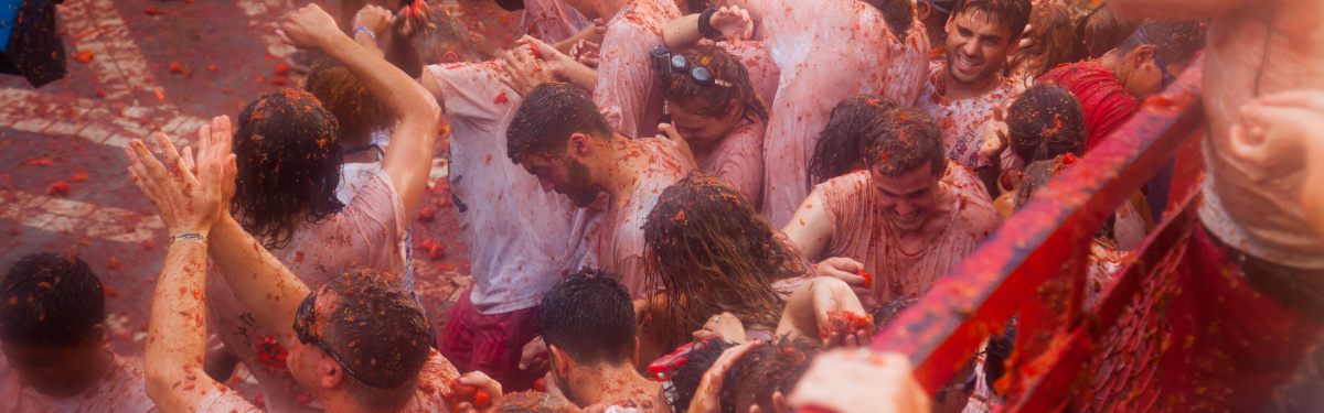 BUNOL, SPAIN - AUGUST 30, 2018: People during La Tomatina festival. La Tomatina festival where people are fighting with tomatoes at street