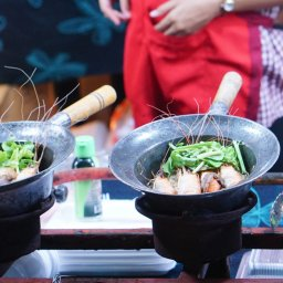 Close up shot of the cooking the vermicelli noodle with prawn in the cooking pot on the street in Thailand