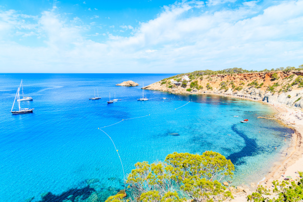 View of Cala d'Hort bay with beautiful azure blue sea water, Ibiza island, Spain